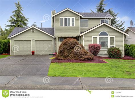 Shed Plans With Porch House Exterior View Of Garage And Driveway Stock Photo