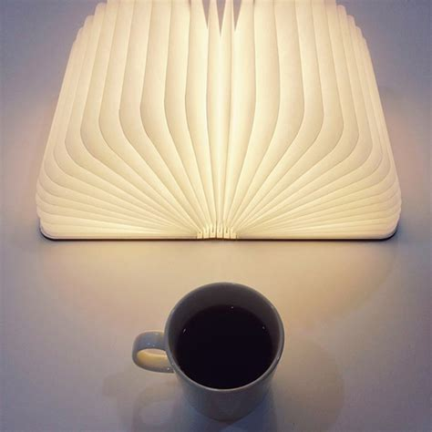 lumio a portable light that opens up like a book design