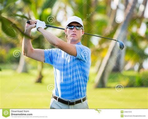 hitting or swinging golf athletic young man playing golf stock photo image 34957510