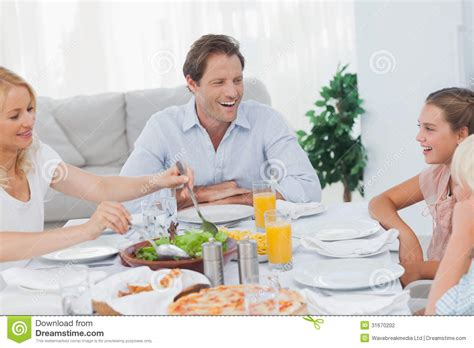 Dining Room Table Seats 8 by Family Around The Dinner Table Stock Photography Image