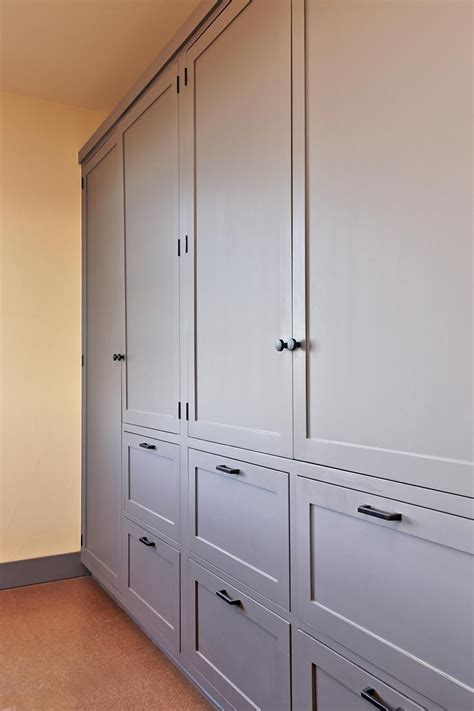 built in wall cabinets a wall of built in cabinets provides plenty of room to
