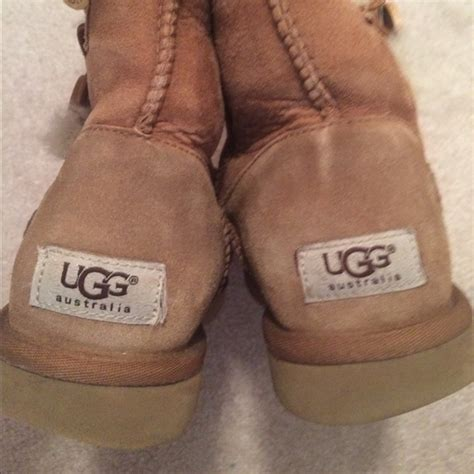 light brown uggs with buttons 55 ugg shoes ugg suade brown fuzzy boots