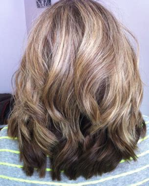 perm and blend gray with blonde another option is a demi permanent translucent color like