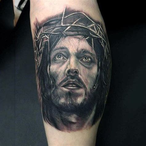 gentleman with jesus christ face tattoo on leg calf