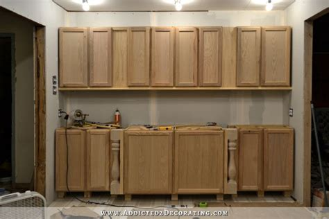 installing used kitchen cabinets diy decorative feet for stock cabinets