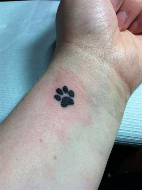 footprint tattoos on wrist paw print wrist i finally did it