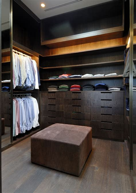 Masculine Closet by Masculine Closet With Wood Cabinetry A Leather