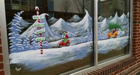 window painting signs christmas holiday seasonal artist johnson city press how the grinch stole downtown johnson