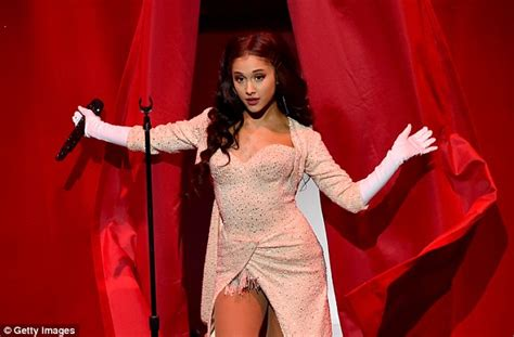 how did ariana grande hair fall off ariana grande lets her hair down to perform new song focus