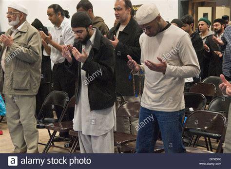 men standing to pray at eid milad un nabi celebrations at