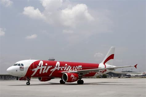 airasia support airasia weighs bnp credit suisse rhb to help sell