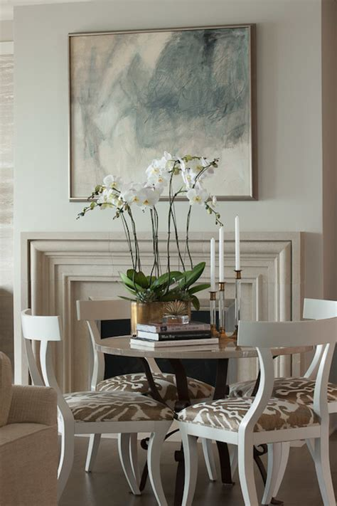 dining table in front of fireplace limestone fireplace transitional dining room james