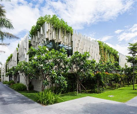 green home building and sustainable architecture eco yoga lush living plants engulf the green roofed pure spa in