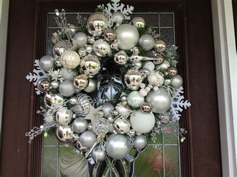silver and white christmas ornaments wreath by hanginabout