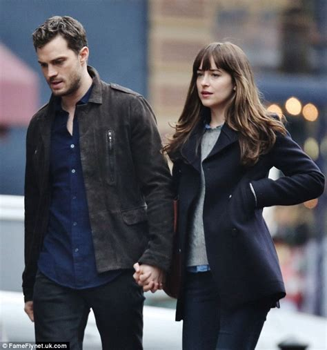 fifty shades of grey actors together dakota johnson and jamie dornan holding hands on the fifty