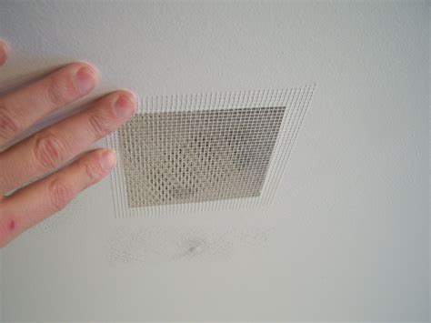 fix hole in wall drywall repair for my dining room ceiling all about the