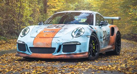 gulf porsche 911 porsche 911 gt3 rs poses with rusty gulf livery