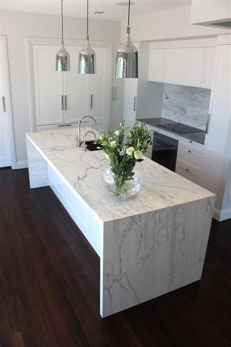 marble bench top my kitchen carrara marble waterfall benchtop and splashback copacabana pendants and