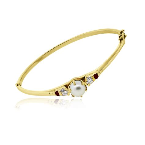 And Bracelet 14k yellow gold pearl and ruby bangle bracelet