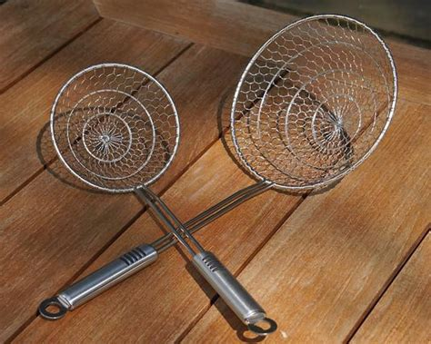Spider Kitchen Tool by Stainless Steel Spider Strainer S Kitchen