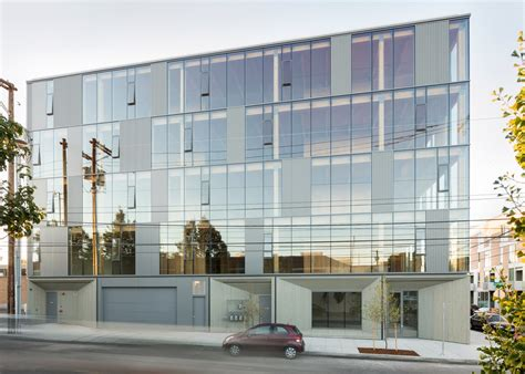 glass curtain wall building glass facade reveals timber structure of portland office