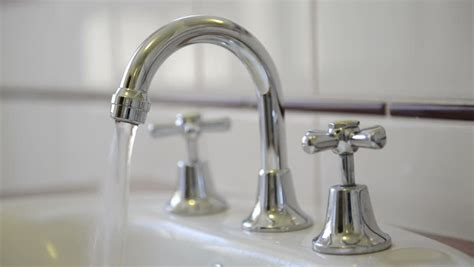 Running Faucet by Turning Water Bathtub Faucet In The Bathroom
