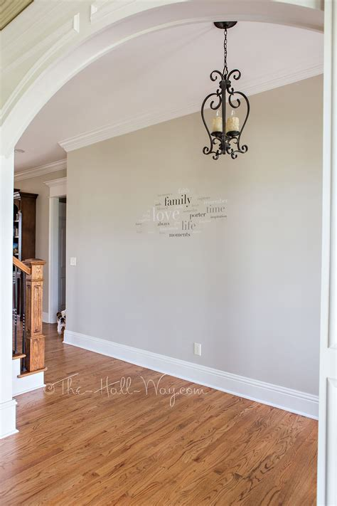 foyer with behr sculptor clay and silky white trim paint