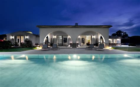 house with pool arched pool house at night interior design ideas