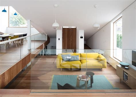split level house interior decorating a sloping green roof hides the split level interior of belgium s discrete house pibo