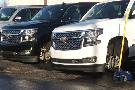 tires rims stolen from 8 suvs at cadillac dealership 9
