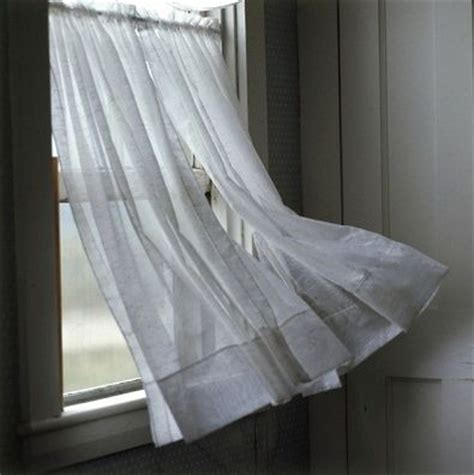 wind blowing curtains wind blowing a curtain on a window royalty free images