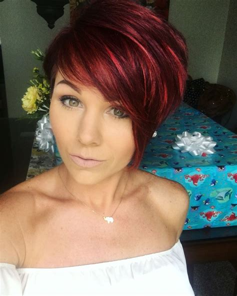 funky asymmetrical haircut style for older women redhair pixie shorthair hairstyles inspiration