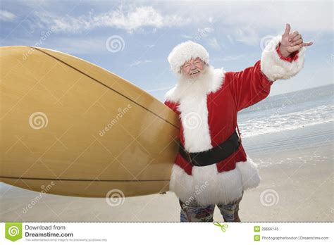 santa claus with surf board on beach stock image image
