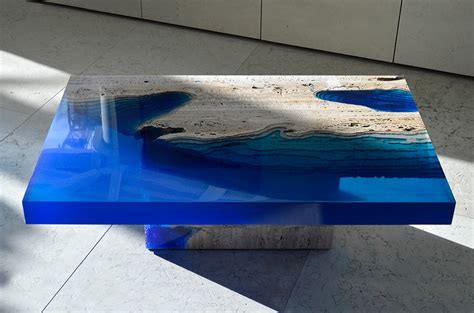 Glow In The Dark Table by Cut Travertine Marble And Resin Merge To Create Lagoon