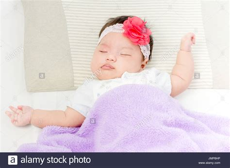 hat on the bed peaceful sleep young toddler girl stock photos peaceful sleep young toddler girl