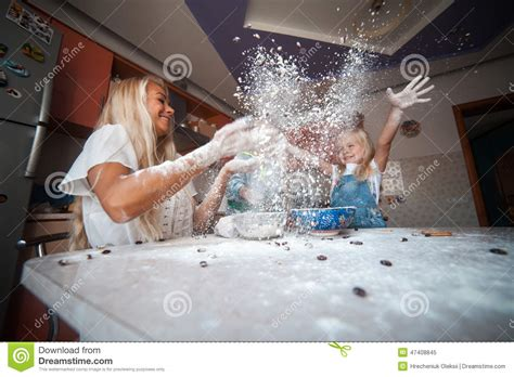 Table Throw Mother With Kids On Kitchen Throw Flour To The Top Stock