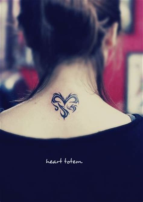 heartbeat tattoo back of neck a heart tattoo on the back consist with totem type of