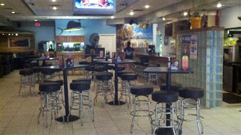 inside bar and high top tables at back picture of