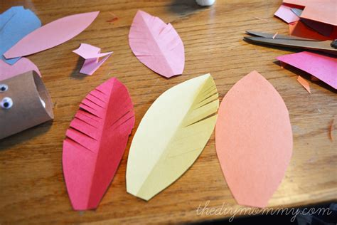 How To Make Feathers Out Of Construction Paper - make turkey placeholders from toilet paper rolls a kid s