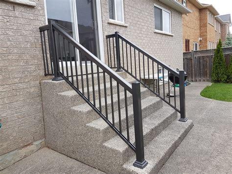 Picket Fences aluminum railing over cobblestone steps aluminum