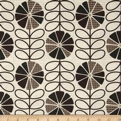 light brown and cream houndstooth upholstery and by black gray and tan houndstooth fabric grey brown black