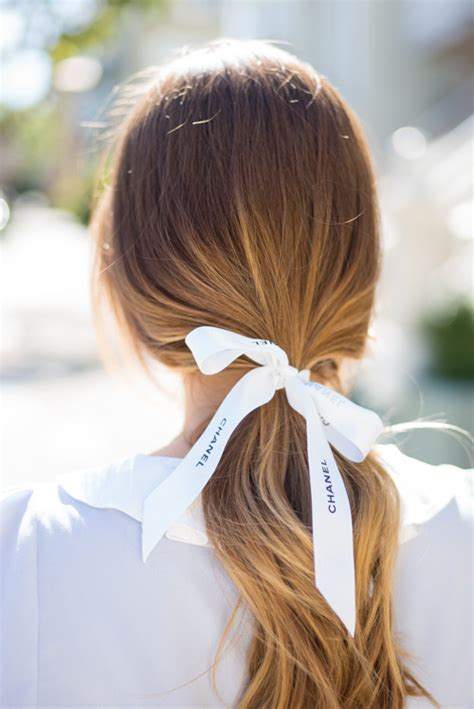 bow in her hair and rear view hair tied with a bow gal meets glam