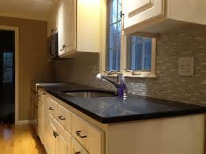 bold black quartz countertops as the top of cabinets and