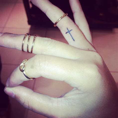tattoo cross in finger cross on finger tattoo tumblr www imgkid com the image