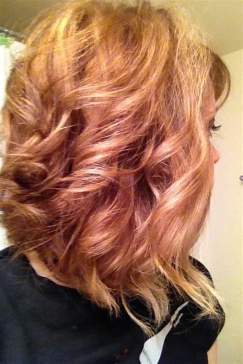 blonde and copper hairstyles copper lowlights blonde highlights curly swing bob hair