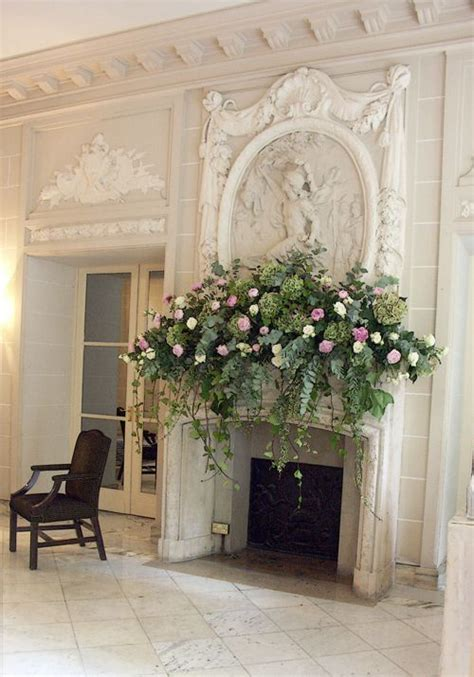 not this full but drapey beautiful fireplace with floral arrangement on the mantle mantles