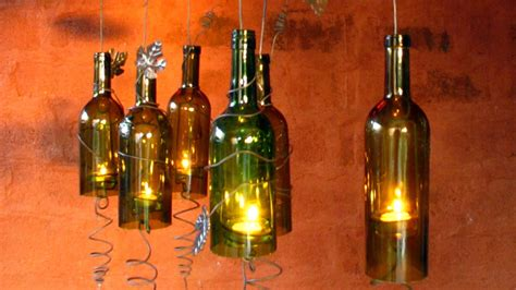 diy recycled wine bottles made into a hurricane candle holder diy joy