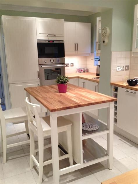 butcher block island but with stools and seating on both sides our house