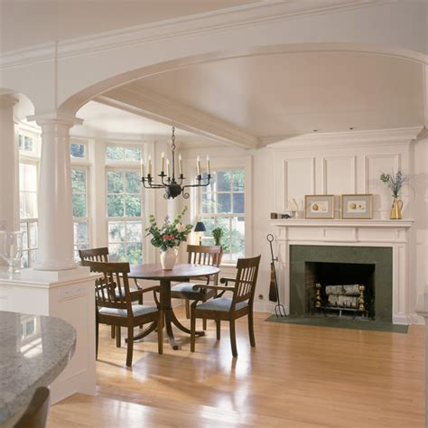 Kitchen Island Table Combo by White Kitchen And Breakfast Room With Fireplace And Arches