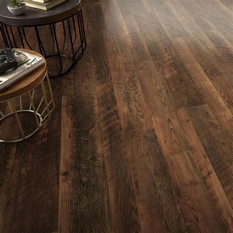 knotty pine pergo our new flooring for the entire downstairs lowe s quot saddle pine quot the house